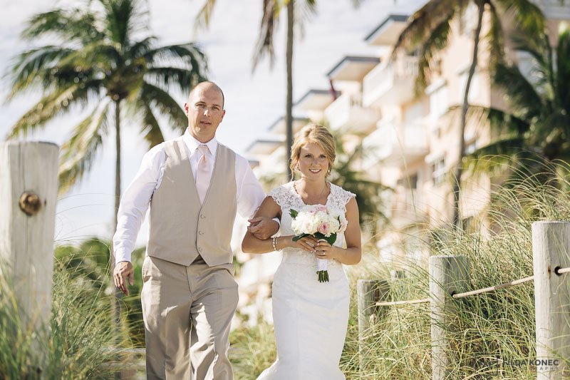 father walks his daughter to her beach wedding in the florida keys