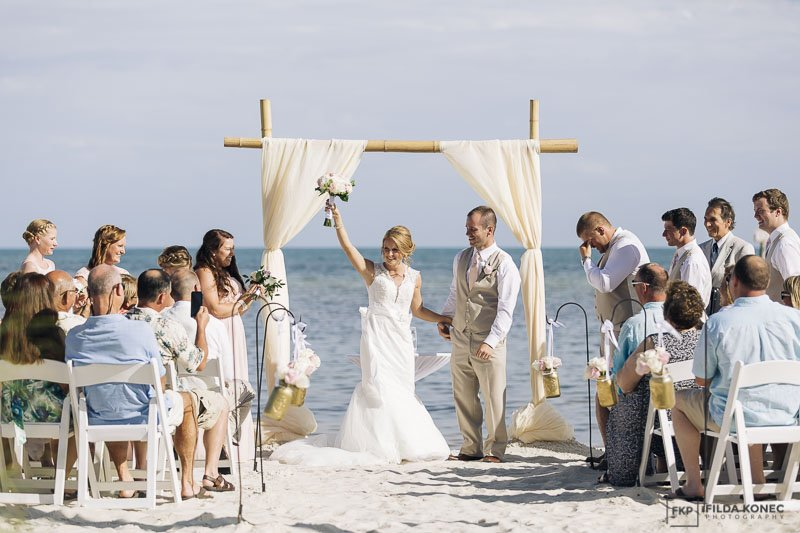 husband and wife after their beach ceremony