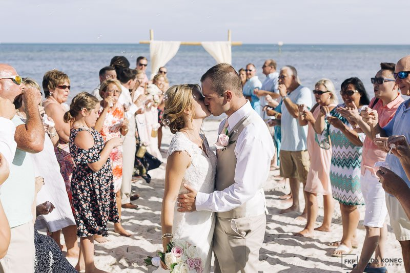 photo of bride and groom at the beach wedding
