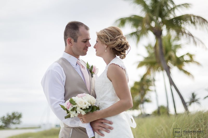 married on the beach in key west with palm trees