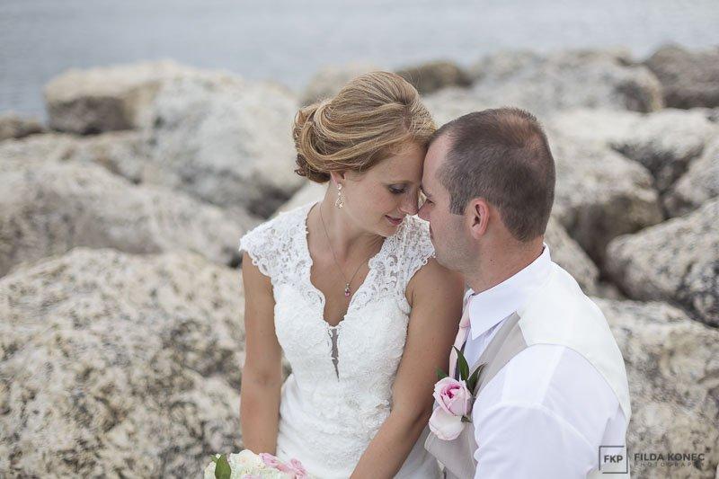 wedding photo on the beach with rocks