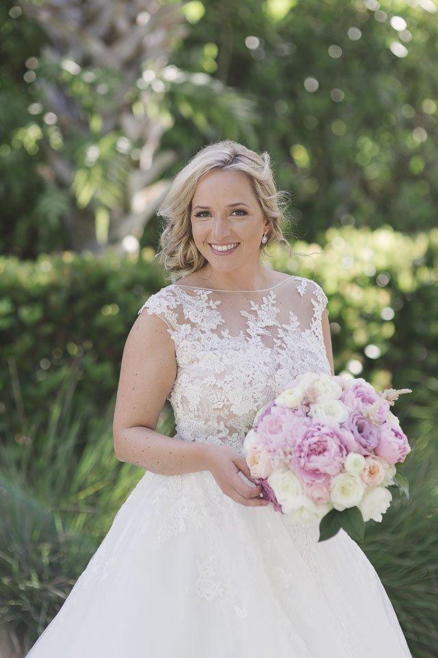 smiling bride in garden at key west wedding