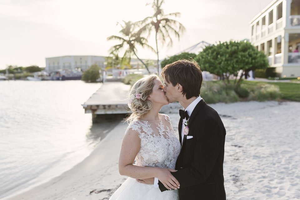 bride and groom kiss at key west wedding venue