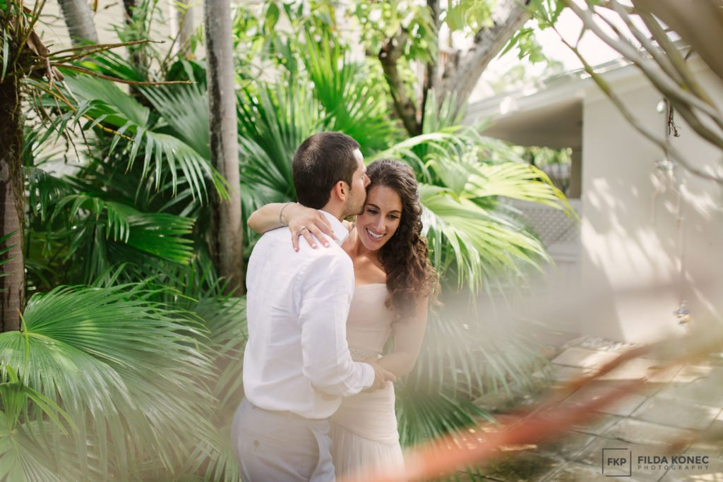 bride laughs with her groom in key west garden
