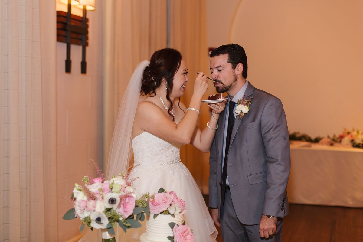 bride feeds groom wedding cake at casa marina