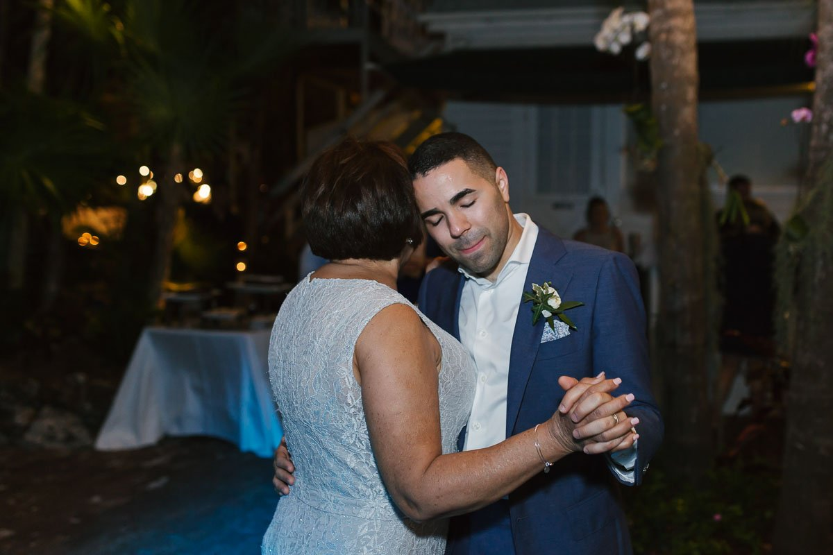 groom dancing with his mom at wedding reception