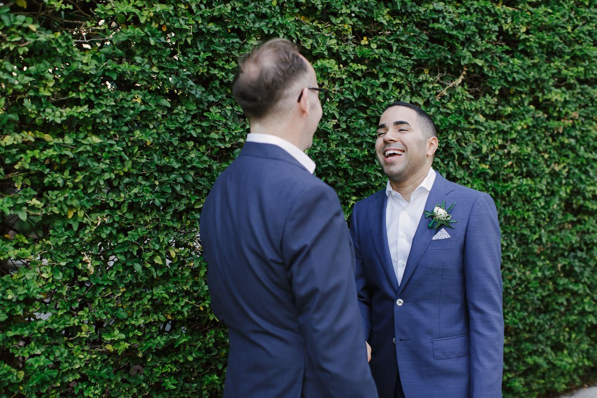 groom laughing with his groom on this wedding photograph near duval street in key west florida