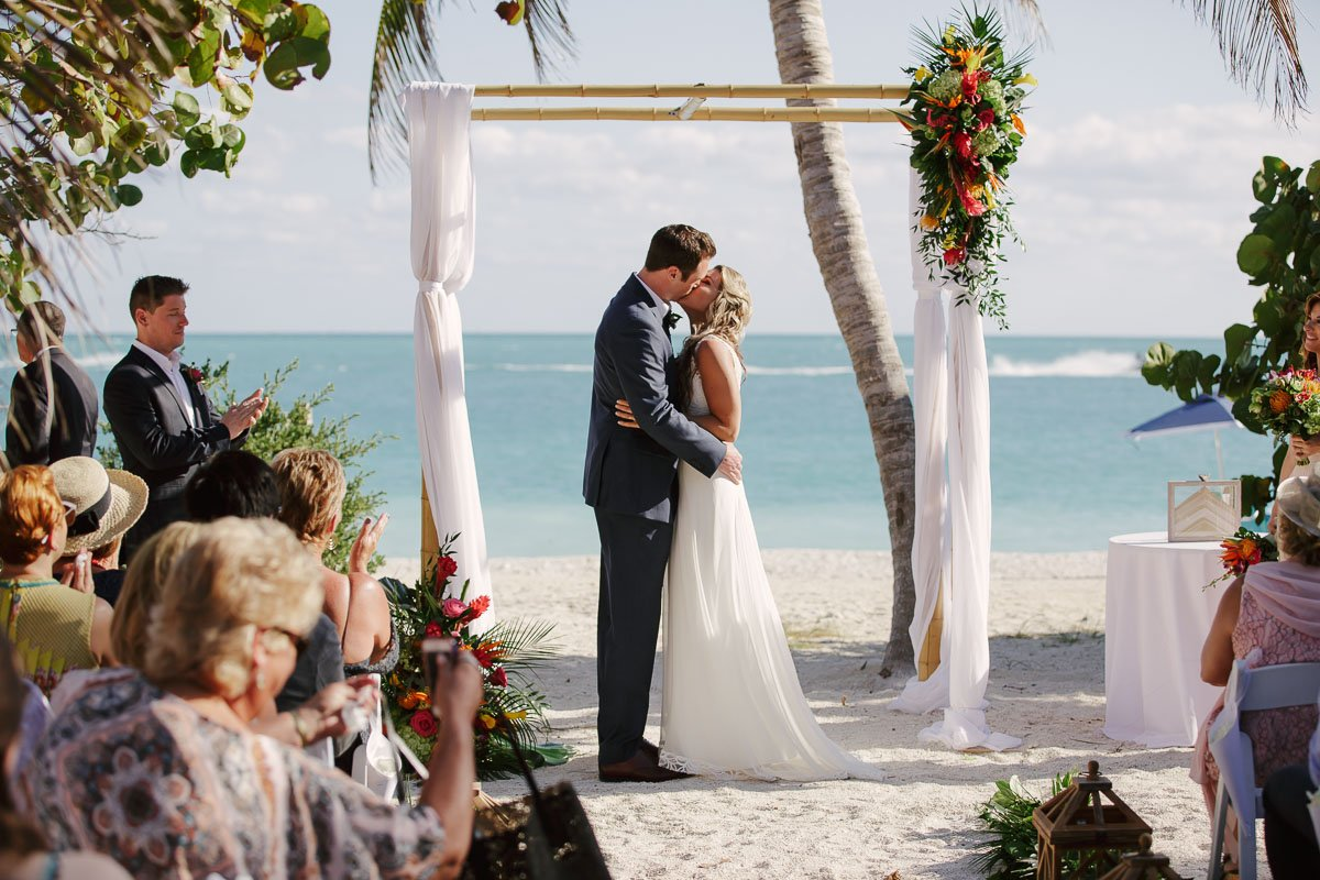newlyweds first kiss in key west beach wedding ideas