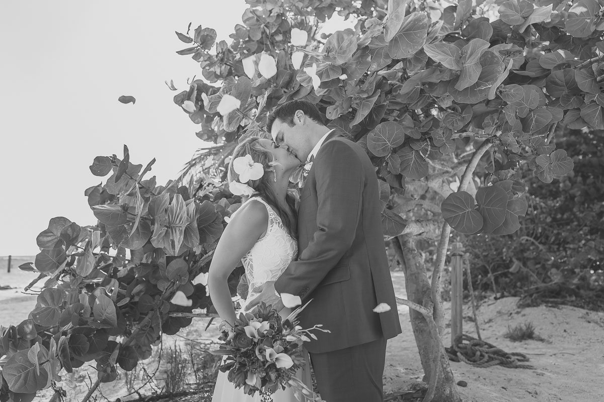 black and white newlyweds love kiss