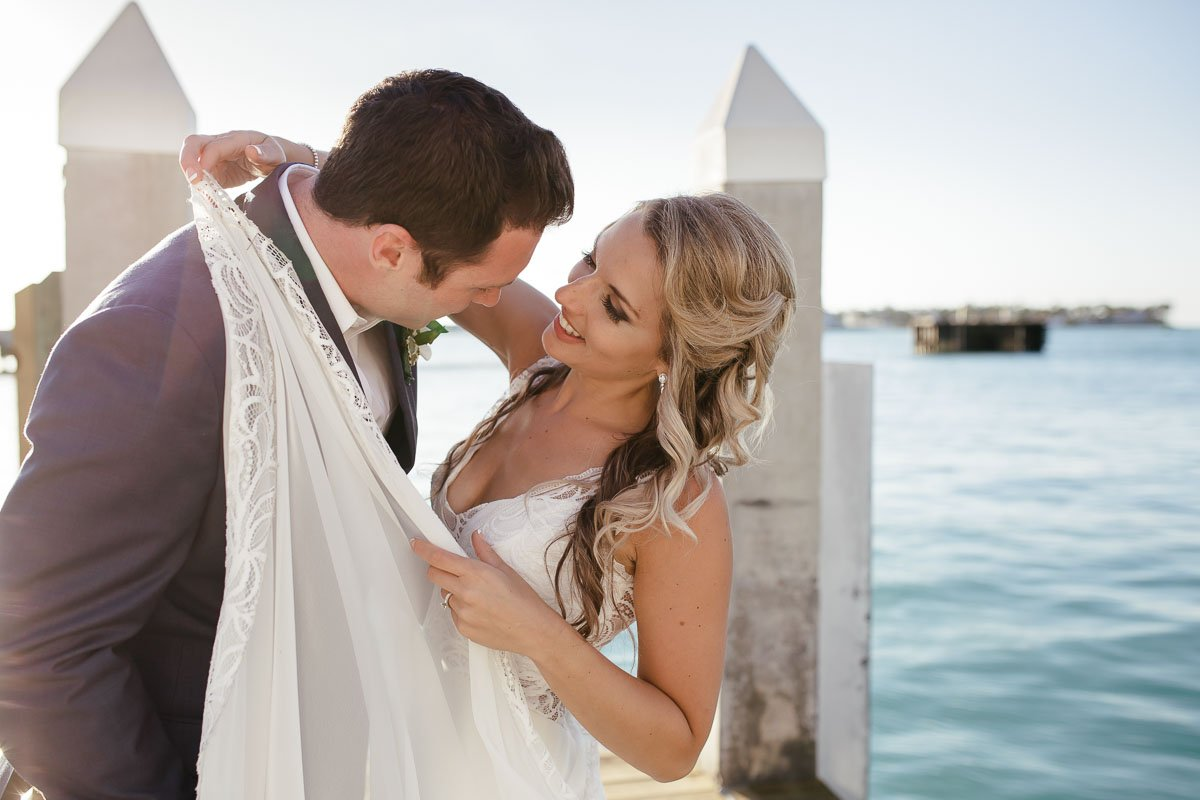 bride smiles at her groom by the ocean in key west