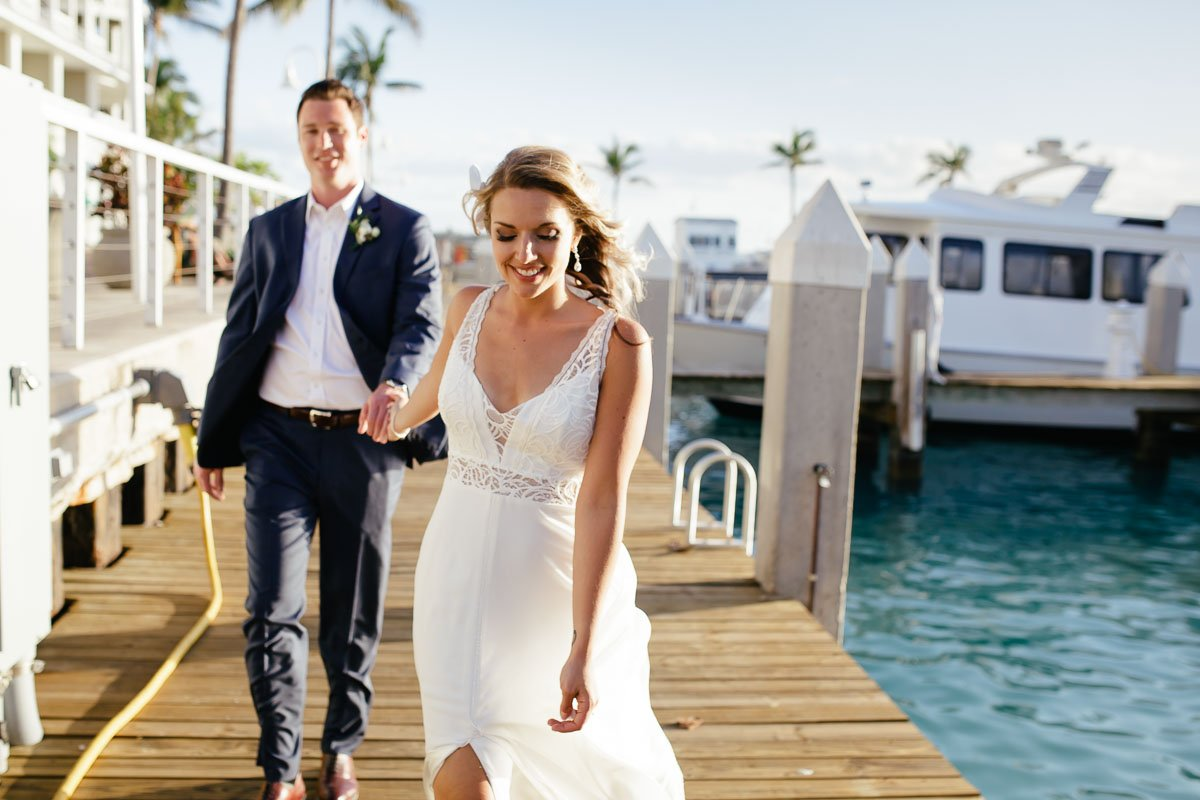 bride and groom walking on key west pier