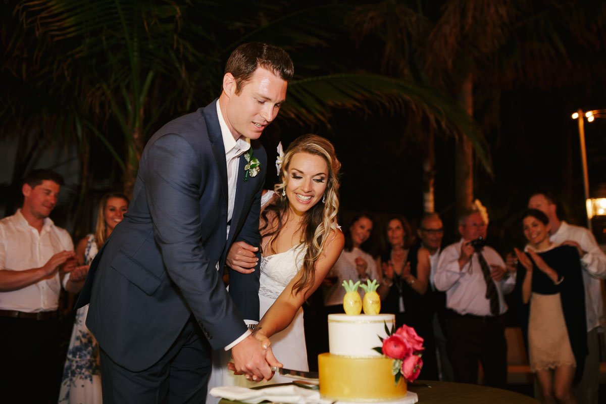 groom and bride cut their wedding cake in key west