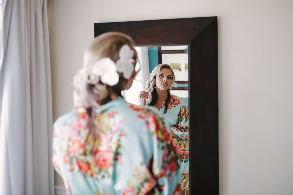bride looks into the mirror
