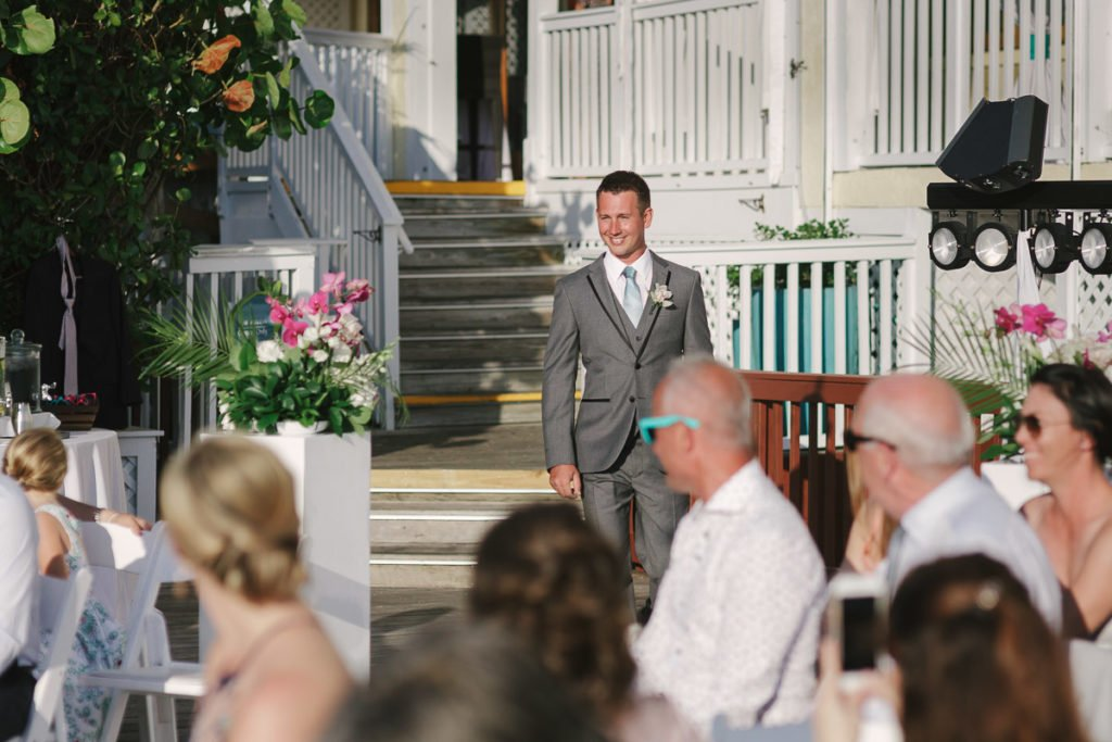 groom walks down the isle for his key west wedding