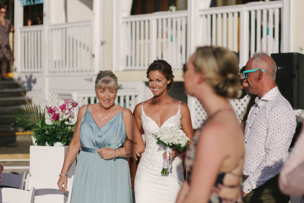 bride walks down the isle for her key west wedding