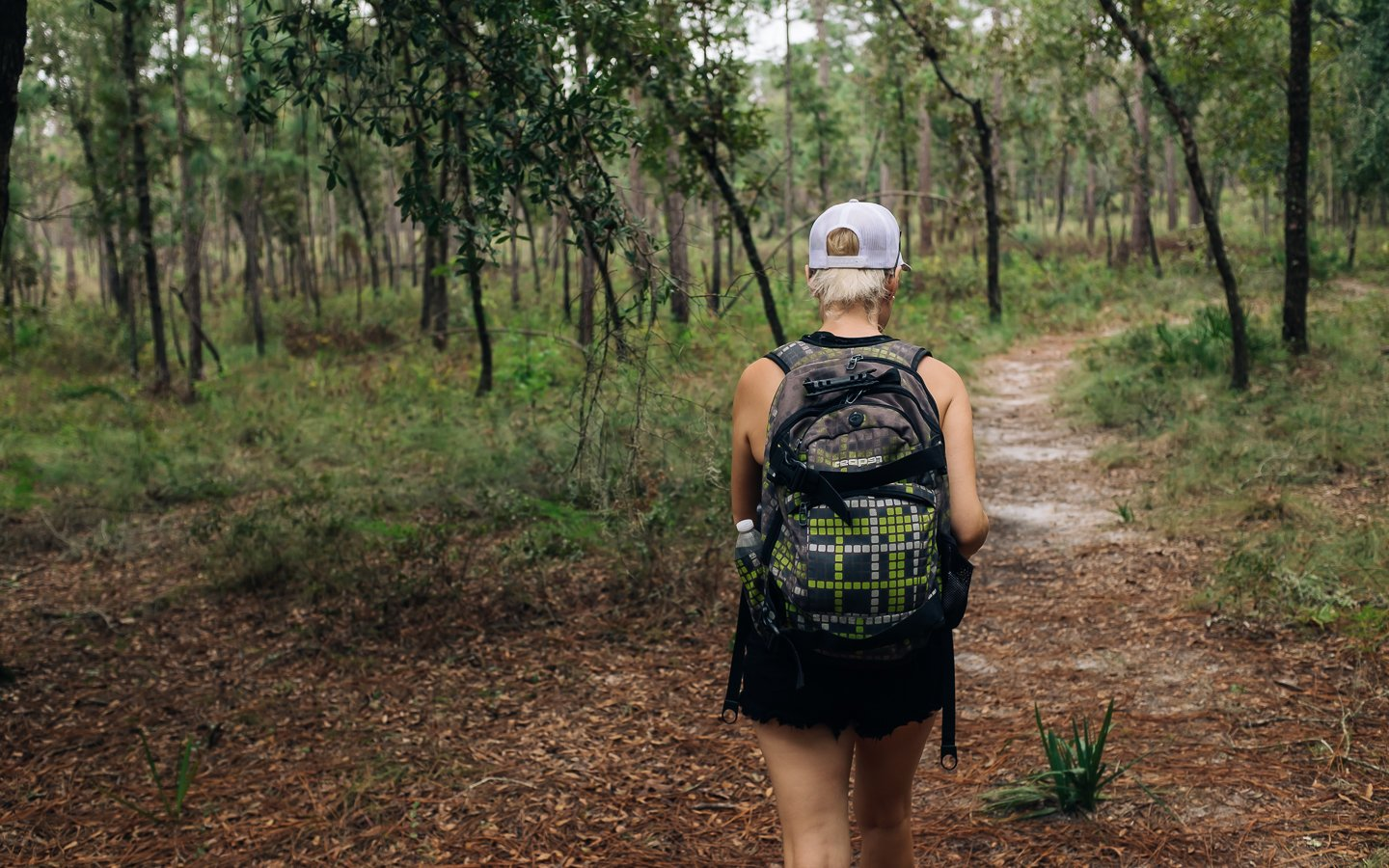 girl hiking in central florida forest