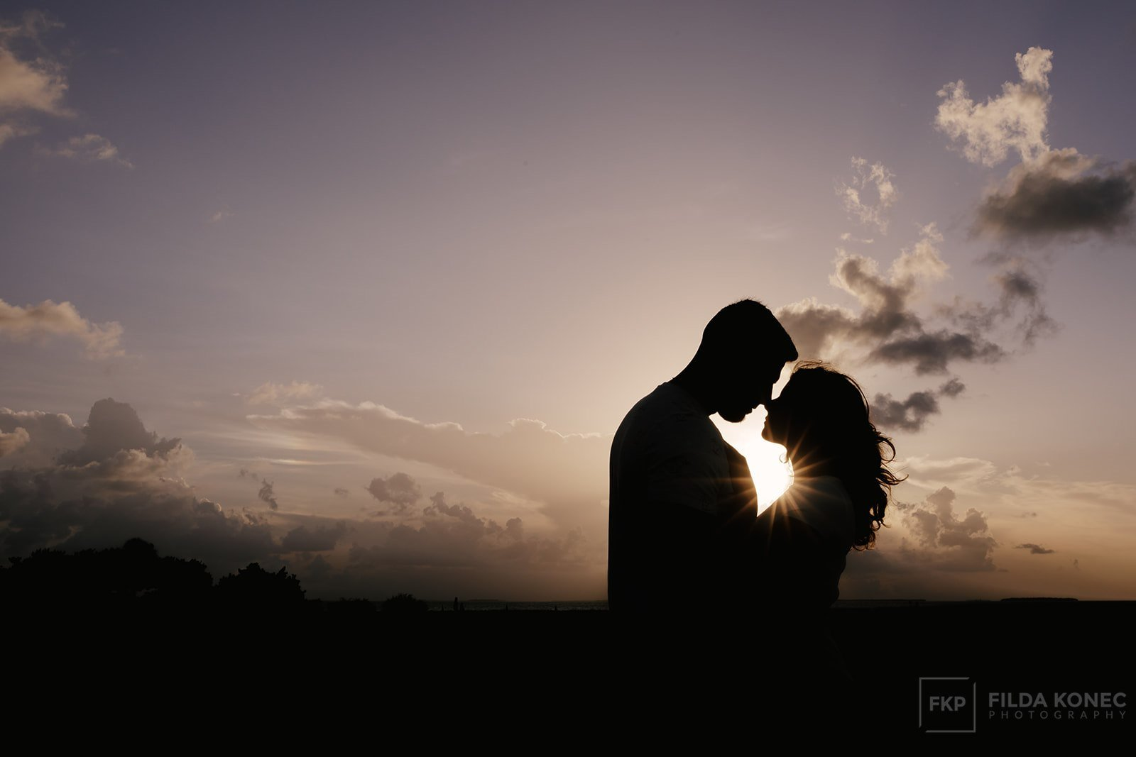 silhouette of hugging couple engaged in key west florida