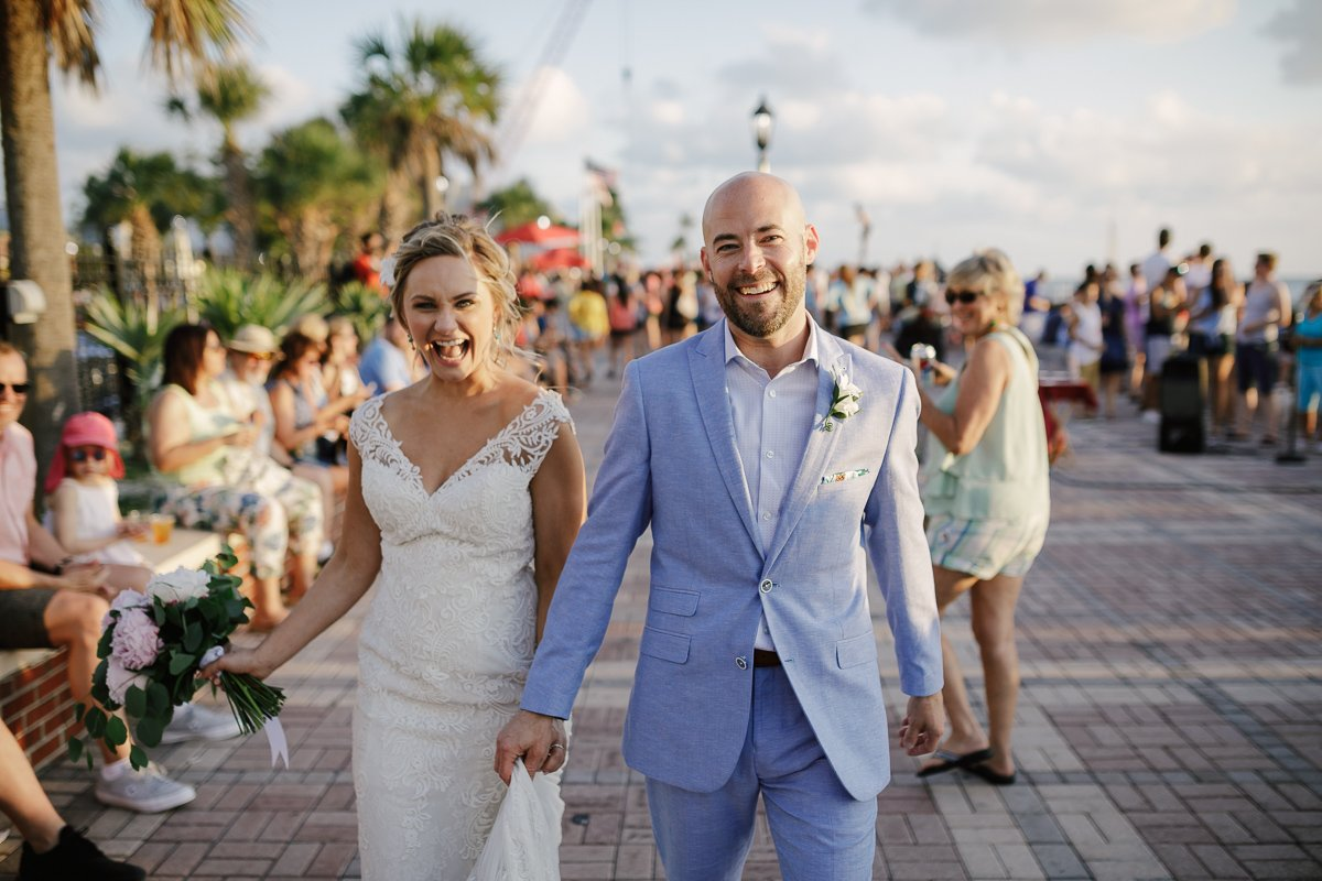 Bride & Groom kiss at Mallory Square in Key West, Florida