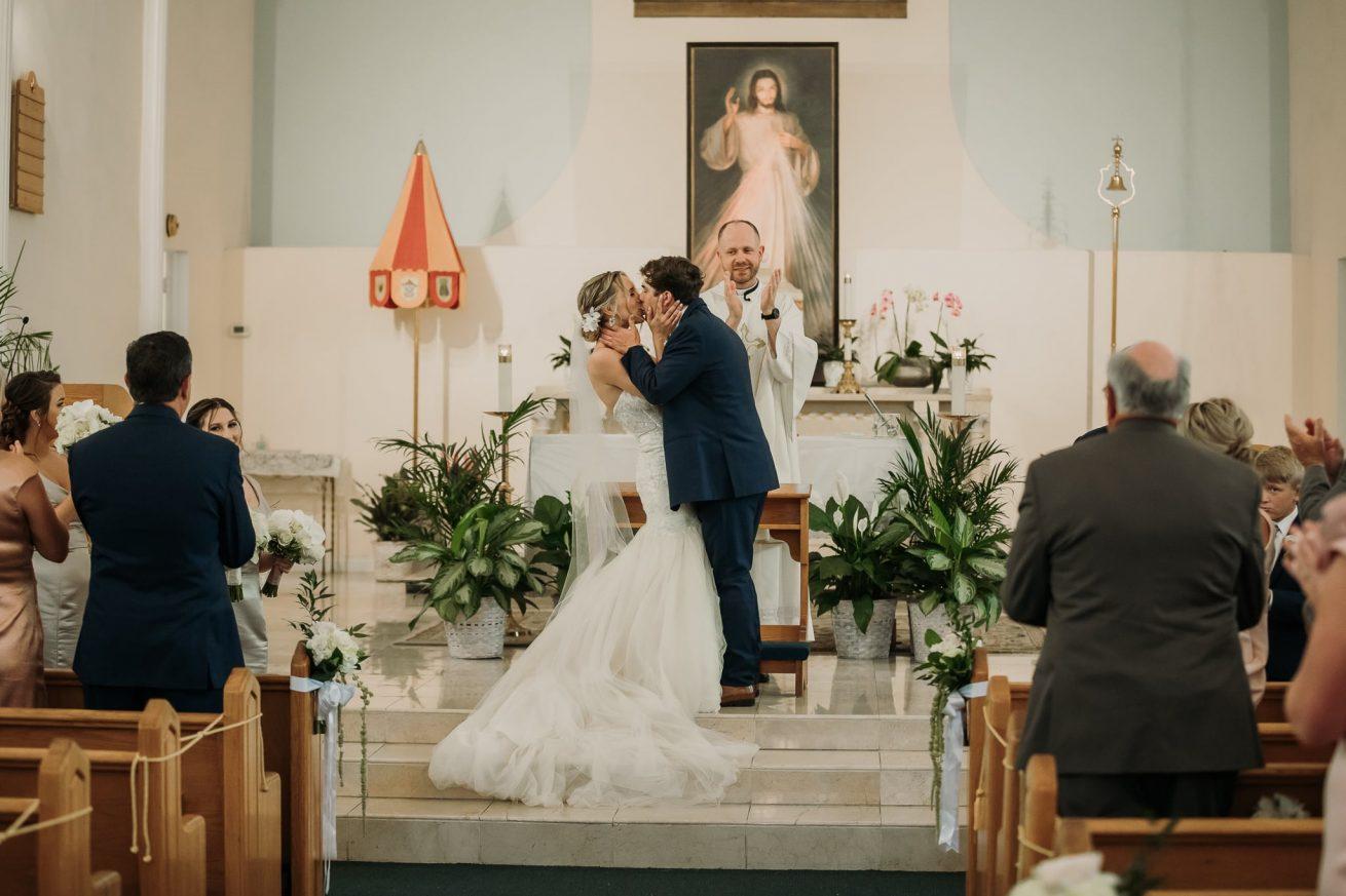 bride and groom kiss in key west florida wedding