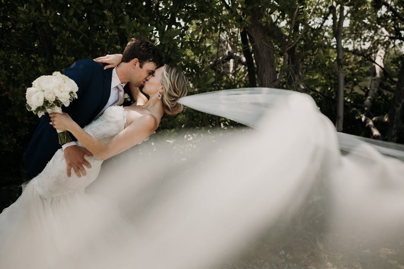 bride and groom kiss in key west florida wedding